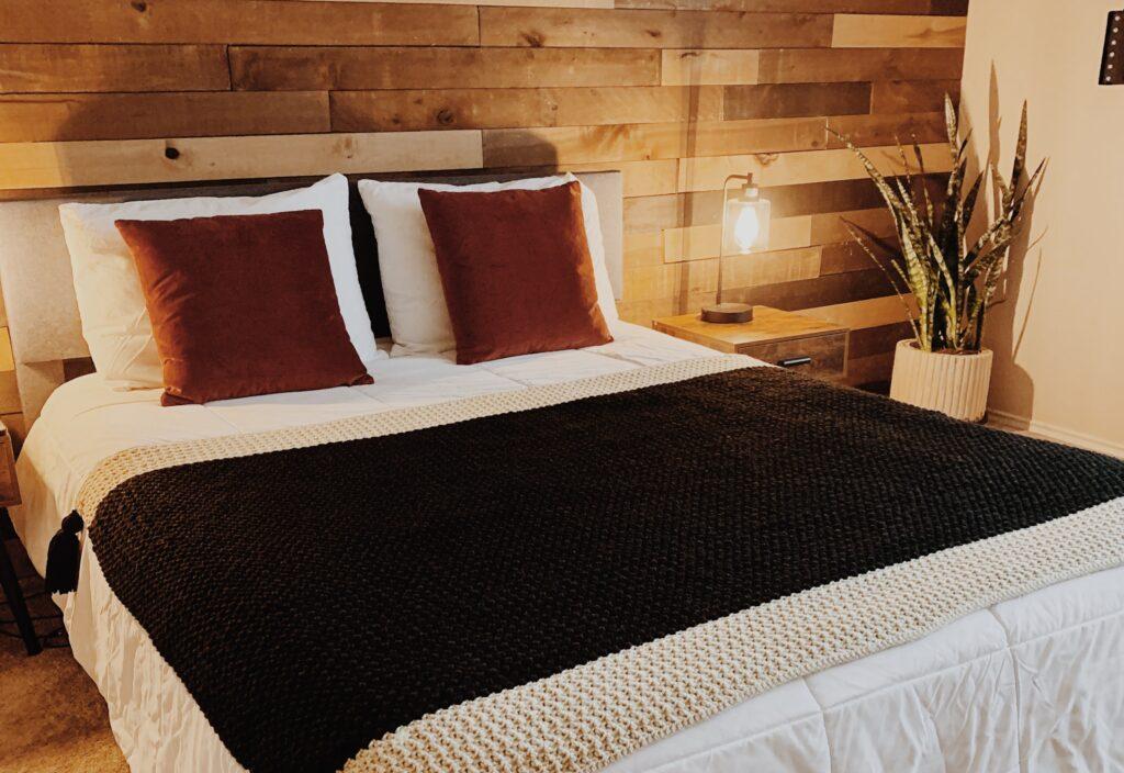 crochet blanket on queen size bed
